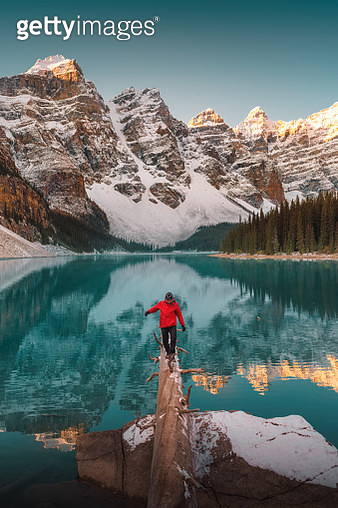Man at Moraine lake at sunrise, Banff, Canada - gettyimageskorea