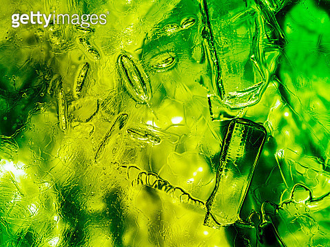 Full frame of the textures formed of a block of cracked ice on a green color background. - gettyimageskorea
