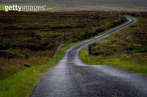 Curving rural road in Scottish countryside - gettyimageskorea