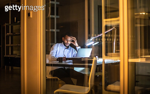 Overworked Businessman Working Late in The Office - gettyimageskorea