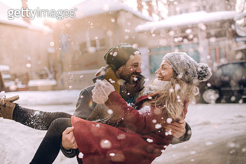 Romantic couple on a snowy day - gettyimageskorea