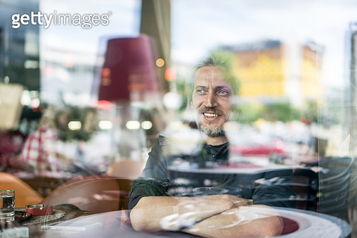 Happy smiling man sitting in coffeeshop - gettyimageskorea