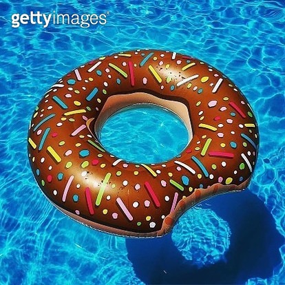 High Angle View Of Inflatable Ring In Swimming Pool - gettyimageskorea
