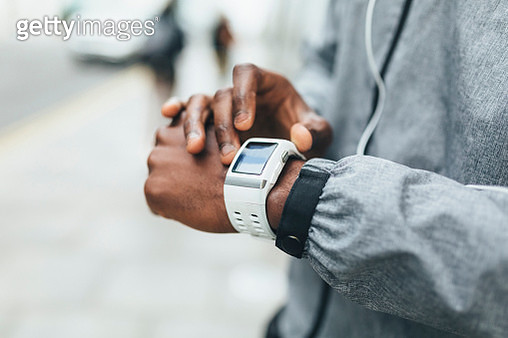 Close-up of athlete using smartwatch - gettyimageskorea