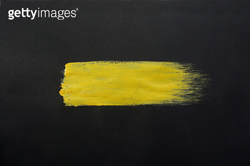 Gold paint stroke on a black background. - gettyimageskorea