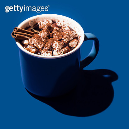 High Angle View Of Hot Chocolate With Marshmallows Over Blue Background - gettyimageskorea