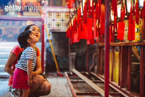 Mom & child admiring lanterns in Chinese temple - gettyimageskorea