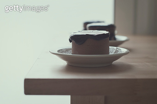Three Chocolate desserts on a wooden table - gettyimageskorea