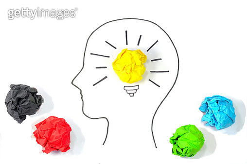 Concept of Creative Ideas and Innovation. Bulb glowing inside human head with crumpled papers around. - gettyimageskorea