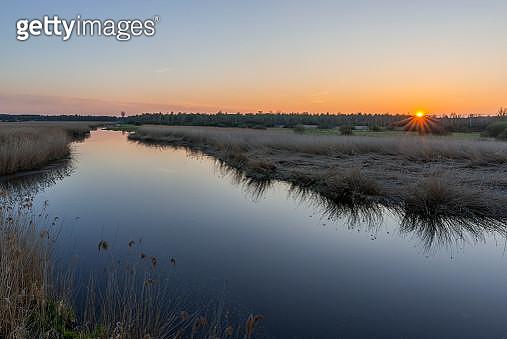 Germany, Bad Buchau, Lake Feder at sunset - gettyimageskorea