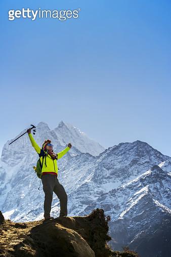 Trekker appreciating the nature during Everest Base Camp trekking in Nepal. - gettyimageskorea
