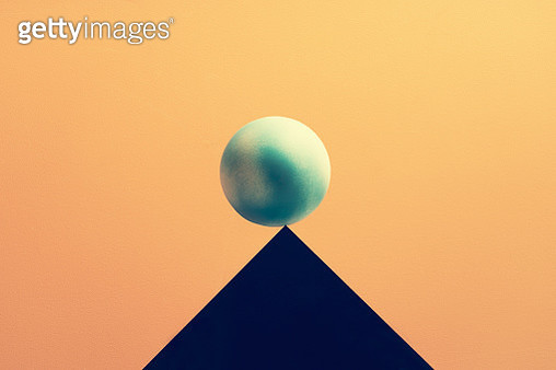 Earth balancing on a peak, symbolizing the fragile nature of our planet - gettyimageskorea