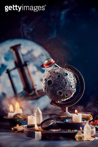 Moon globe with candles and smoke in astronomy still life with copy space - gettyimageskorea