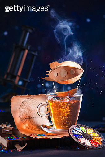 Steampunk tea with paper blimp in steam, creative food photography - gettyimageskorea