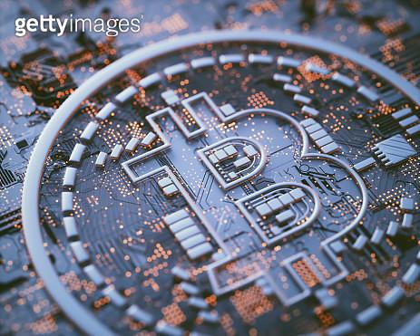 Bitcoin logo on circuit board, illustration - gettyimageskorea
