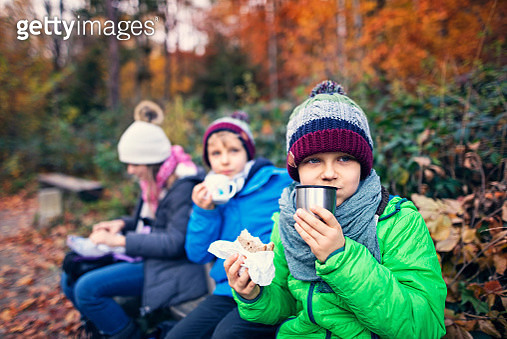Children hikers eating in autumn forest - gettyimageskorea