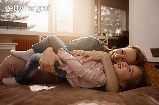 Mother and daughter having fun - gettyimageskorea