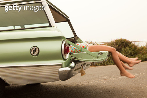 Two girls lying in estate car - gettyimageskorea