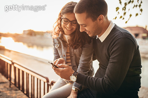 Happy young couple walking at the street - gettyimageskorea
