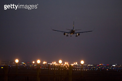 airplane just before landing. Runway lights can be seen in the foreground,Shanghai,China - gettyimageskorea