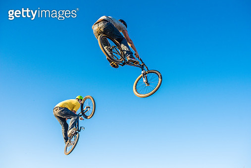 Men enjoying dirt jumping sport - gettyimageskorea