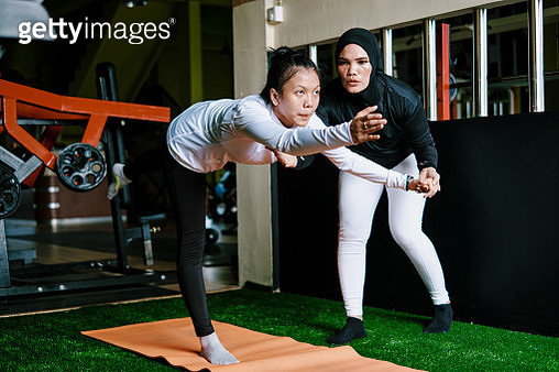 Mother Support Her Daughter Doing Body Stretching Exercise at The Gym - gettyimageskorea