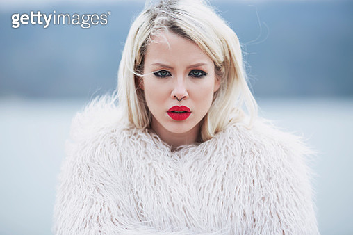 Portrait of a young woman in a fur jacket. - gettyimageskorea