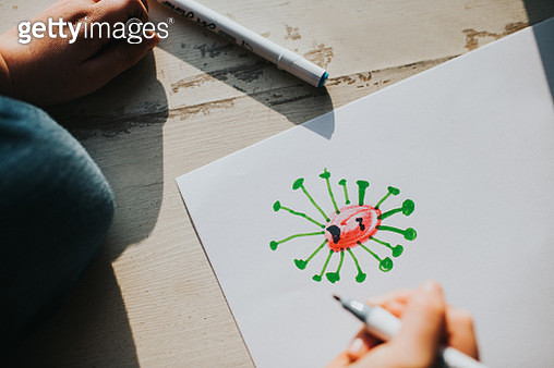 Child Drawing a Germ - gettyimageskorea