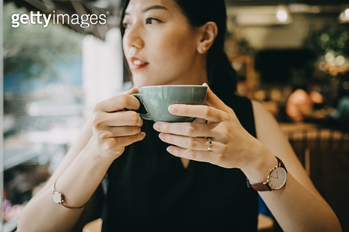 Beautiful young woman enjoying coffee in cafe - gettyimageskorea