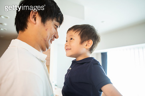 Father and son playing together at home on holidays - gettyimageskorea