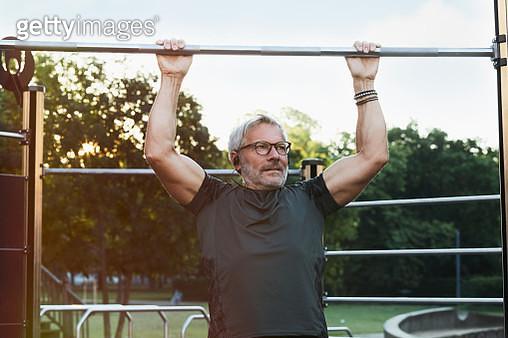 elderly handsome man exercising in an outdoor gym - gettyimageskorea