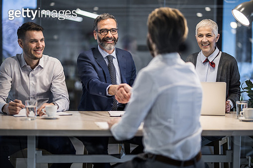 Happy human resource team congratulating a candidate on successful job interview. - gettyimageskorea