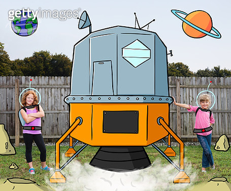 Two girls (7 and 9 yrs old) posing next to their illustrated lunar spacecraft. - gettyimageskorea