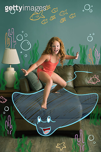 9 year old girl riding on the back of an illustrated Stingray in a cartoon underwater environment. - gettyimageskorea