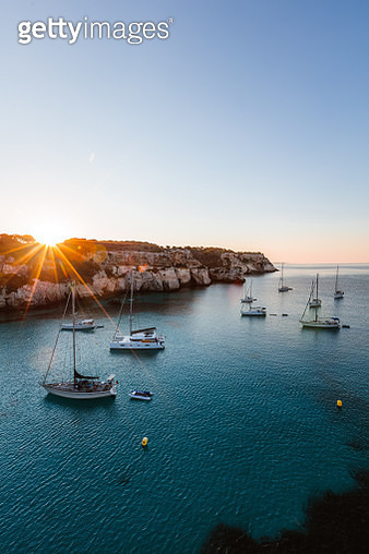 Sunrise over yachts in the Mediterranean sea, Spain - gettyimageskorea