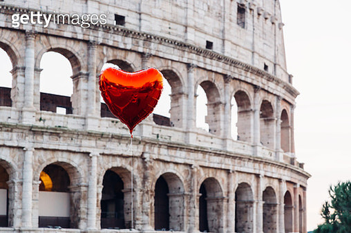 Heart shaped balloon floating near Coliseum, Rome, Italy - gettyimageskorea