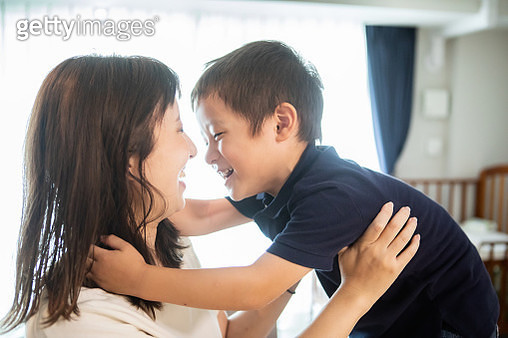 A boy playing with his mother - gettyimageskorea