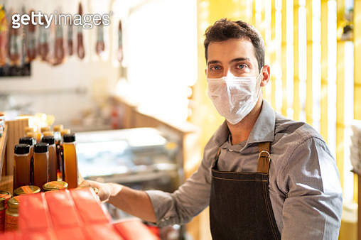 Portrait of young small business man owner with face mask working at store - gettyimageskorea