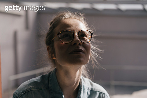 Young woman with glasses looking up - gettyimageskorea