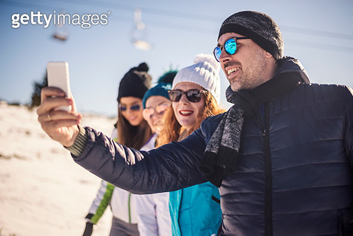 Group of friends having fun outdoors on winter day. - gettyimageskorea