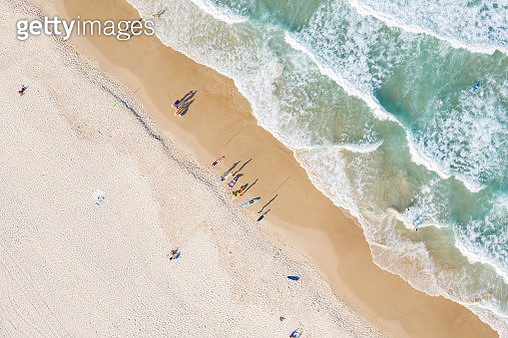 Aerial shot above people swimming in the surf and on the beach on a sunny day at Burleigh heads, Gold Coast, Australia - gettyimageskorea