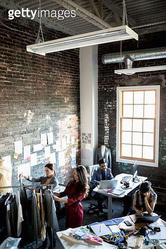 Fashion designers working in loft office - gettyimageskorea