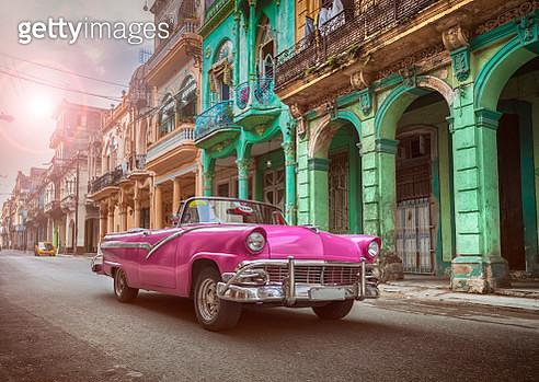 Vintage classic pink american oldtimer convertible in old town of Havana Cuba - gettyimageskorea