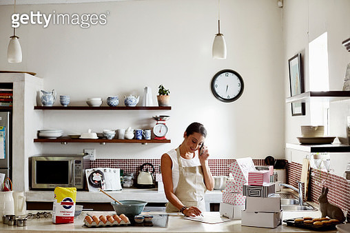 Woman taking order for cupcakes - gettyimageskorea