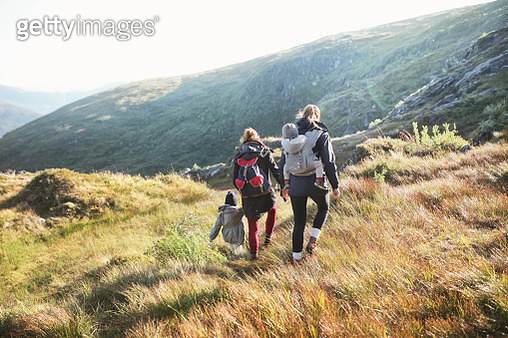 Mothers trekking with daughters in mountains - gettyimageskorea