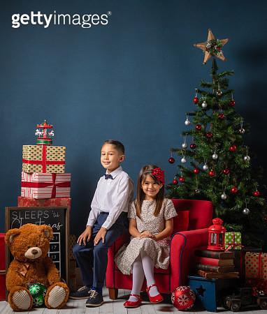 Hispanic brother and sister Christmas time - gettyimageskorea