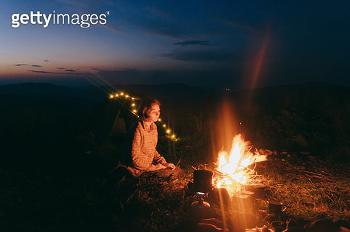 Woman camping in the mountains - gettyimageskorea
