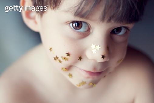 Portrait of boy with gold strar - gettyimageskorea