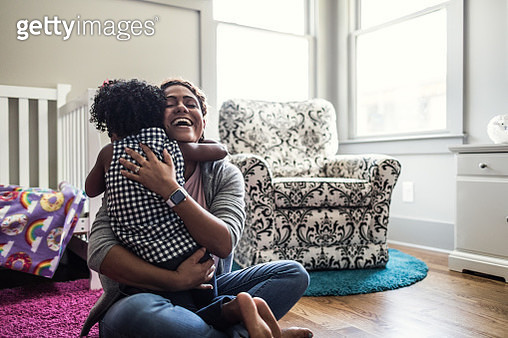 Mother and daughter playing on bedroom floor - gettyimageskorea