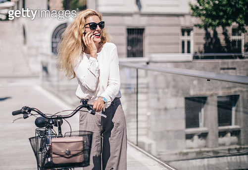 Blonde woman with a bicycle - gettyimageskorea